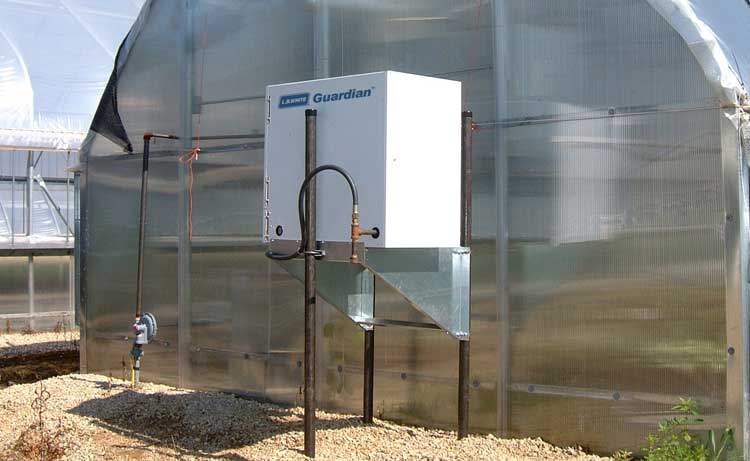 Guardian Forced Air heater mounted outside a greenhouse.
