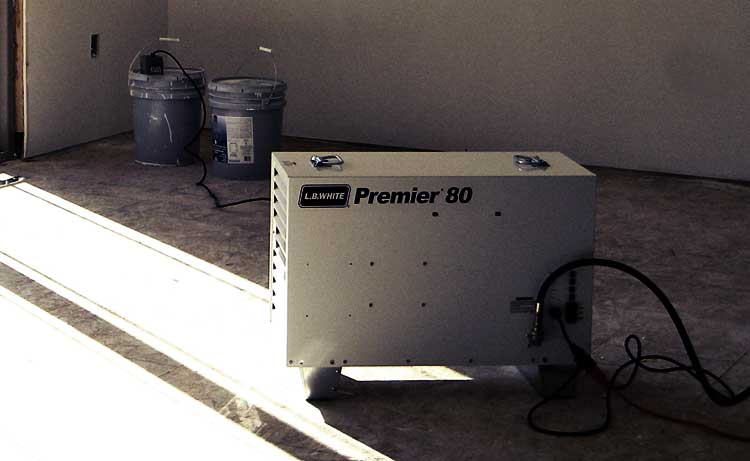 An L.B. White Premier 80 heating a residential home construction location.